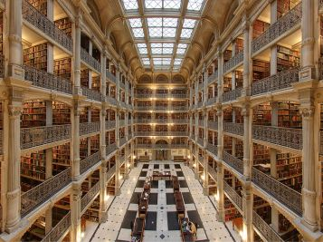 """Interior of the George Peabody Library in Baltimore"" by Matthew Petroff (Own work) is licensed under CC BY-SA 3.0"